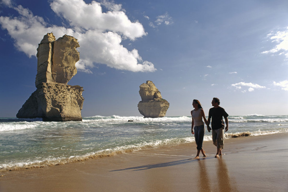 Walk along the beach with Great Walks of Australia on the Twelve Apostles Lodge Walk in Victoria.
