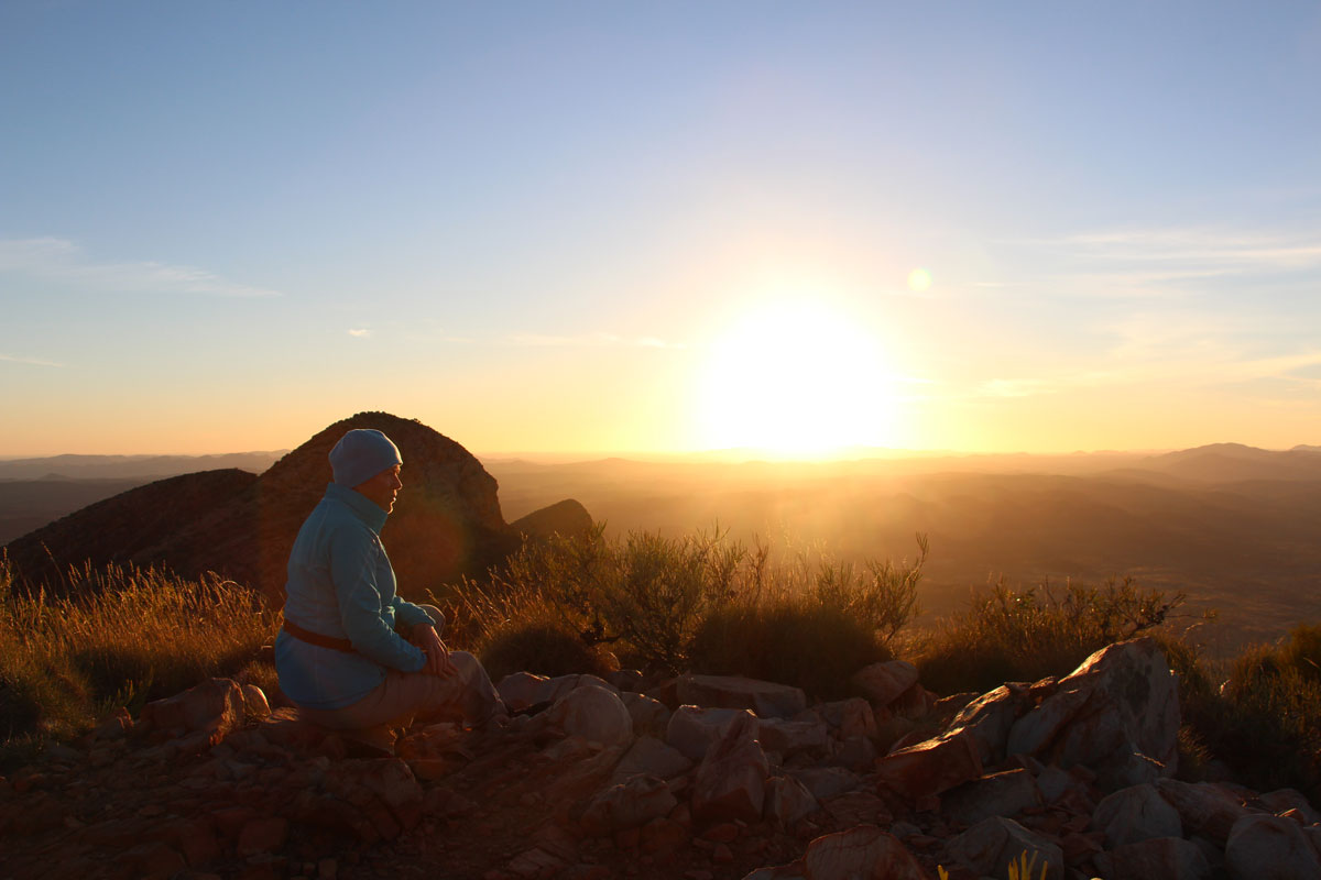 Witness breathtaking sunsets from Mount Sonder in the Northern Territory.