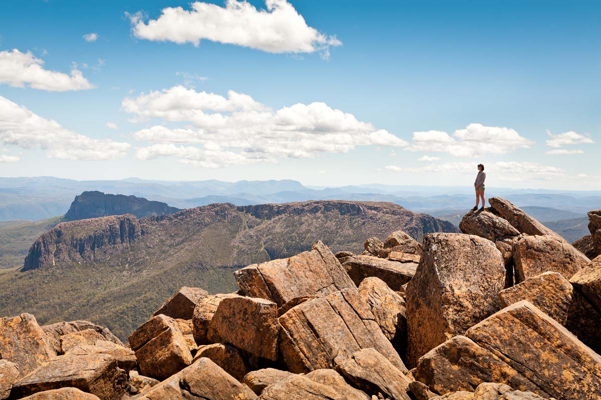 Hike to the top for amazing views on the Cradle Mountain Huts Walk in Tasmania.