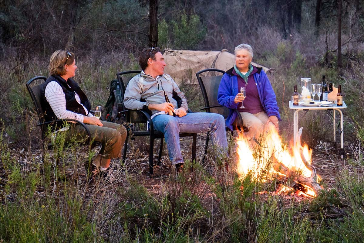 Relax at a riverbank campfire with Great Walks of Australia on the Murray River Walk.