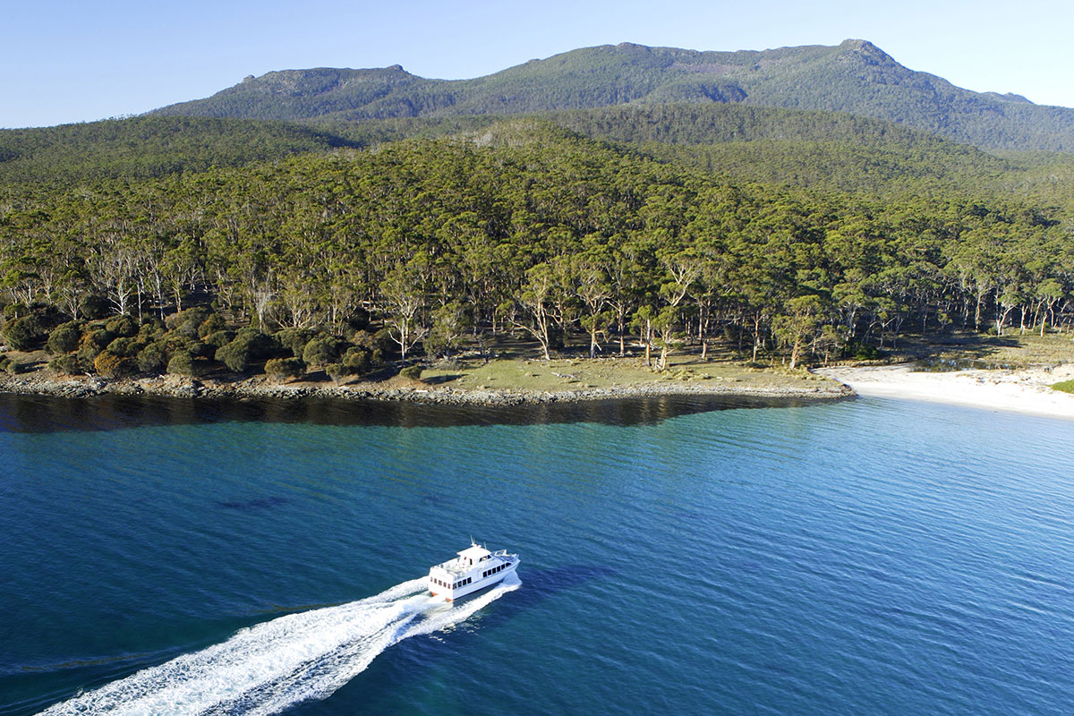 Travel by boat through Mercury Passage to Maria Island in Tasmania.