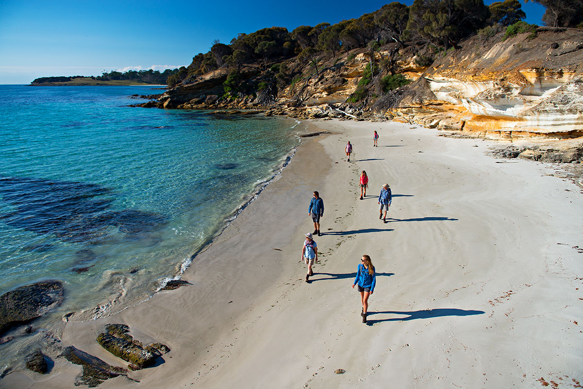 Join other walkers and your guide to explore remote beaches on the Maria Island Walk, Tasmania.